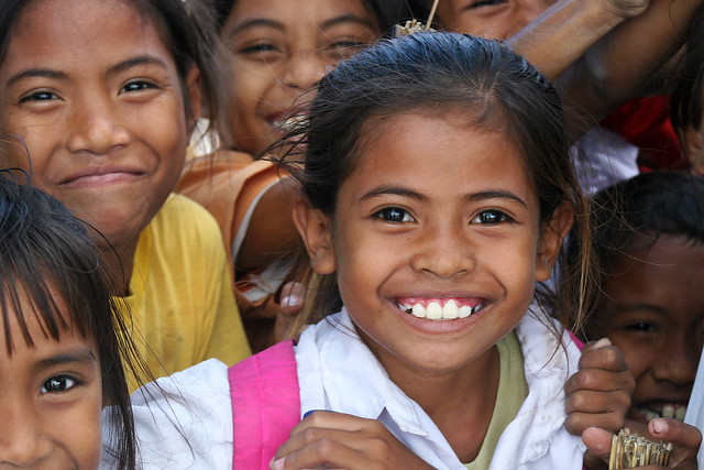 Portrait of a smiling school girl in Timor, Indonesia.