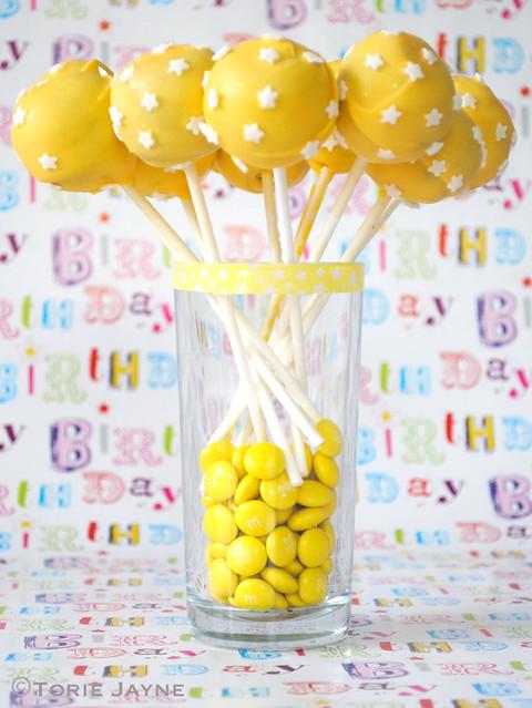 Starry yellow cake pops