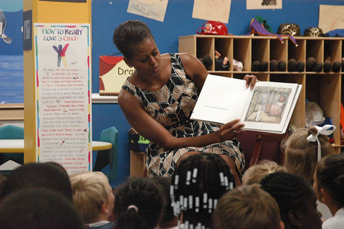 First lady Michelle Obama reads to 5 and 6-year-olds at the Naval Air Station Oceana Child and Youth Programs summer camp