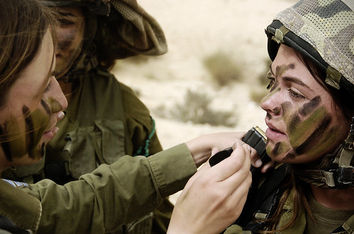Female Soldiers Apply Camouflage Face Paint