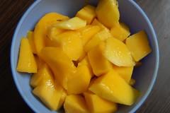 pineapple(0.0), peach(0.0), plant(0.0), calabaza(0.0), produce(0.0), dish(0.0), ananas(0.0), mango(1.0), fruit(1.0), food(1.0),