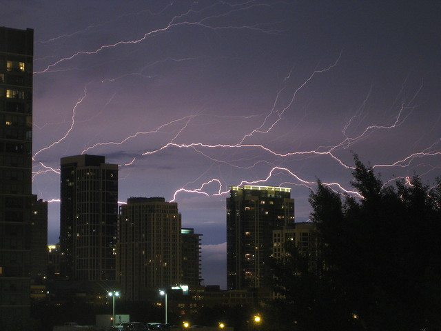 Lightning Streaks Behind Buildings