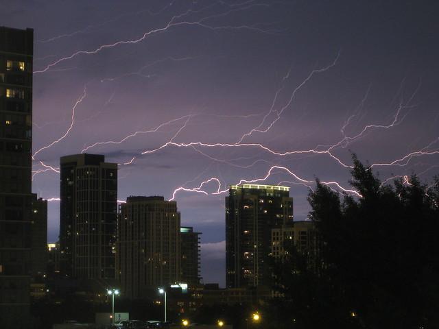Lightning Streaks Behind Buildings