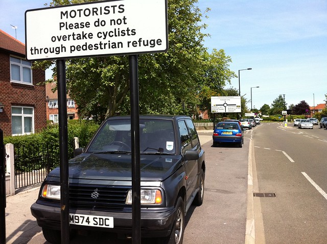 Motorists Please do not overtake cyclists through pedestrian refuge