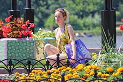 Girl near a flowerbed Updated