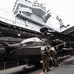 Army Air Corps Apache Helicopter is Lifted to the Flight Deck of HMS Illustrious