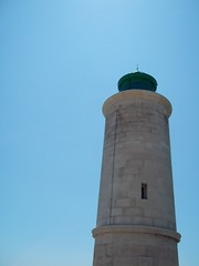 water tower(0.0), control tower(0.0), lighthouse(1.0), tower(1.0), sky(1.0),
