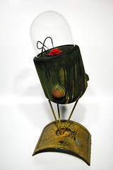 lamp(0.0), light fixture(0.0), sconce(0.0), iron(0.0), ceramic(0.0), lighting(0.0), yellow(1.0), glass(1.0), green(1.0), illustration(1.0),