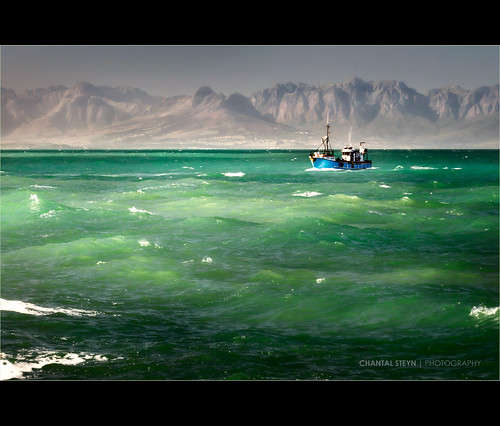 ocean africa blue light sea sunlight mountain seascape mountains green water landscape southafrica boat fishing nikon aqua waves vessel capetown coastal fishingboat illuminate kalkbay westerncape d300 fishingvessel turqois singleshot oceanscape kalkbaai nohdr 1685mm