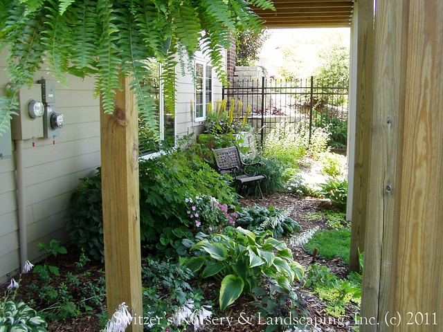 Gardening under the deck... sure! it's aperfect place for a shade garden! This deck is on the side of the house and makes a wonderful place for a secrete garden. A perfect place to get away from it all and just relax.