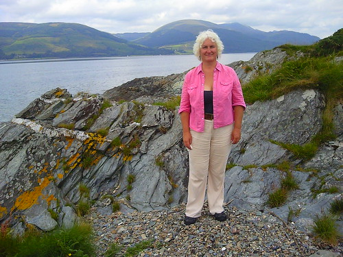 Me by rocks by Loch Long on the Rosneath Peninsula in western Scotland