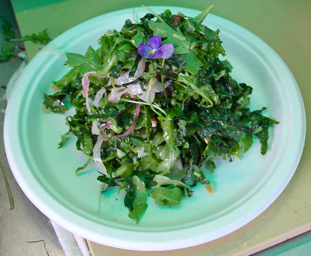 The BBG Café prepared a kale salad with locally sourced ingredients and garnished with a viola from the BBG Herb Garden. Photo by Rebecca Bullene.