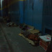 about half a dozen people sleeping on street by blindscapes