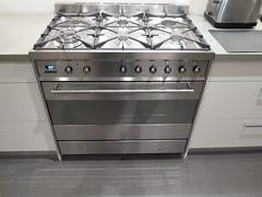 floor(1.0), kitchen(1.0), countertop(1.0), room(1.0), gas stove(1.0), kitchen stove(1.0),