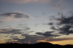 Sunset, evening clouds and forest/antenna profile