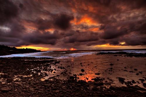 ocean sunrise rocks kauai