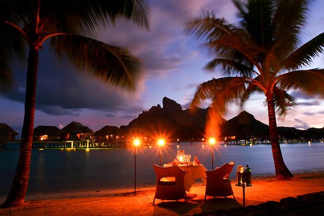 romantic beach dinner at the four seasons resort in bora