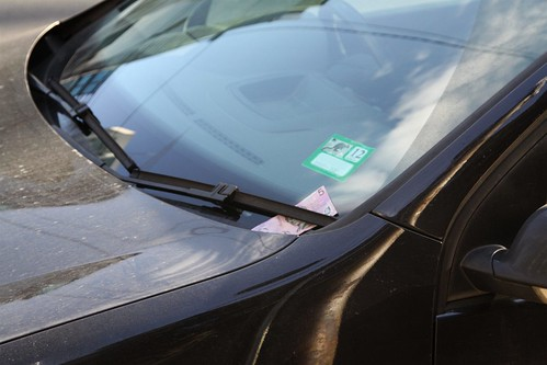Finding a five dollar note underneath your windscreen wiper?