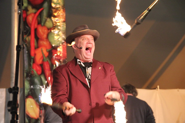 Robbins & Ringold play with fire as the masters of ceremony at the 2011 Chile Pepper Fiesta. Photo by Rebecca Bullene.
