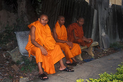 Phnom Penh - Monks sitting on a bench