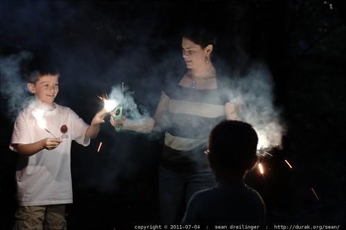 rachel handing nick a sparkler