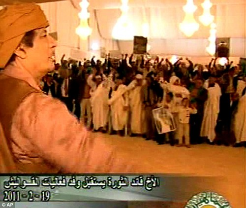Libyan revolutionary Muammar Gaddafi and his supporters demonstrate their animosity toward the US imperialist-led war against this North African oil-rich state. Libya fought for eight months in defense of their country. by Pan-African News Wire File Photos