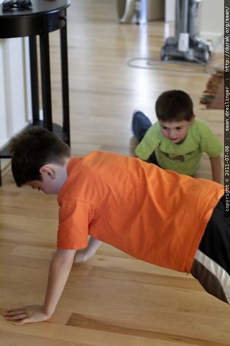 boys doing push ups to impress darika & brian