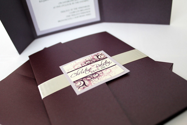 Eggplant and Wisteria colored wedding invitations printed on ivory linen