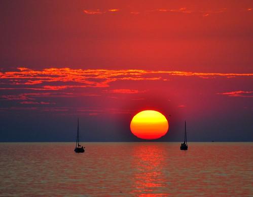 sunset sun nature water sailboat nikon sigma 100v10f lakeontario northcoast pultneyville d5000 flickrchallengegroup perfectsunsetssunrisesandskys