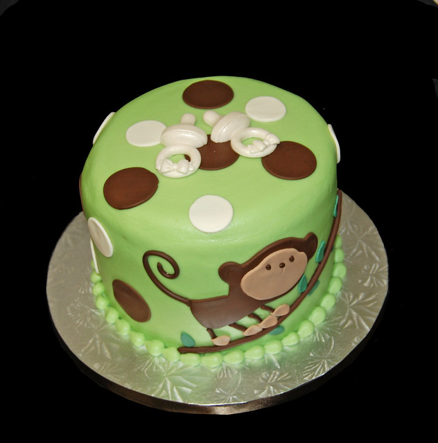green and brown monkey baby shower cake for twins 2 pacifiers flickr