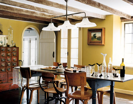 Yellow dining room: Vintage card catalog + exposed beams + Thonet chairs