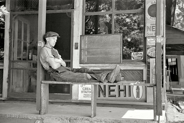 Resting in front of the general store, Blankenship, Indiana, 1938, by Arthur Rothstein