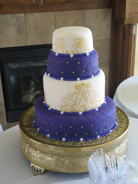 4 tier Purple and Gold Wedding Cake