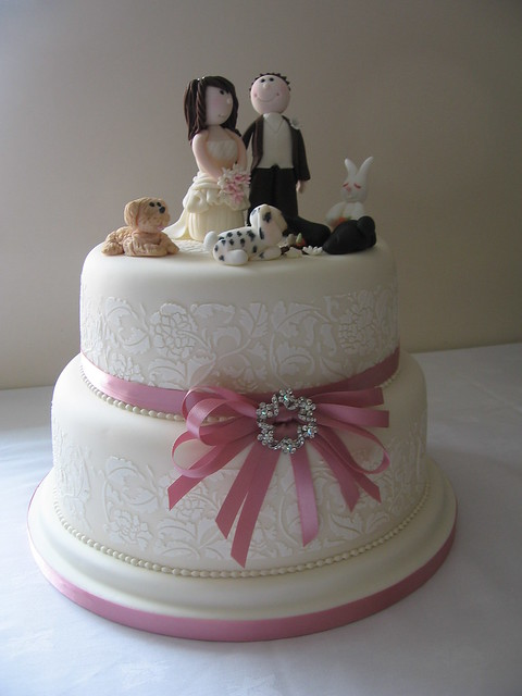 2 tier wedding cake with bride and groom topper and ivory vintage