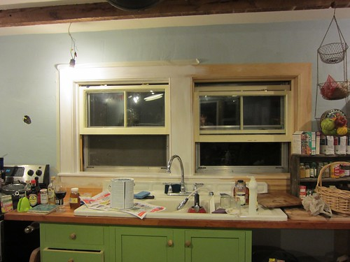 painting the new trim on the kitchen window!