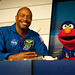 Former Astronaut Leland Melvin speaks with Elmo (201107060004HQ) by NASA HQ PHOTO