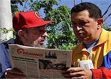 Former Republic of Cuba President Fidel Castro and Venezuelan President Hugo Chavez reading Granma newspaper in Havana. Chavez is in Cuba for medical treatment. The revolutionary leaders exchange views on many topics. by Pan-African News Wire File Photos