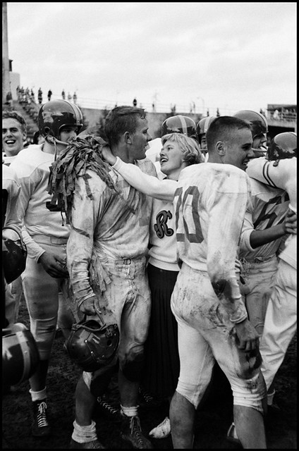 The head cheerleader and the captain of the football team embrace after a game, the team had just won a game for the first time in three years, Seattle, 1955, by Burt Glinn