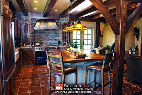 The Kitchen in this 3 Story Log & Timber Home Hybrid