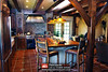 The Kitchen in this 3 Story Log & Timber Home Hybrid by PrecisionCraft Log & Timber Homes