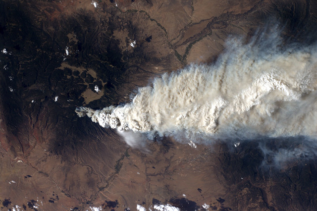 A crew member aboard the International Space Station, flying at an altitude of some 235 statute miles on June 27, 2011, shot this still photograph of the Las Conchas Fire in the Jemez Mountains of the Santa Fe National Forest in north-central New Mexico. The fire is just southwest of Los Alamos National Laboratory.