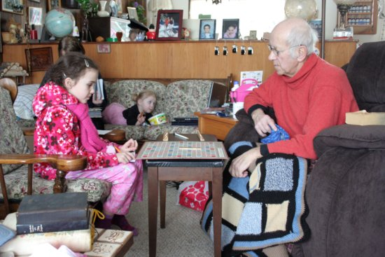 Kaylie and Opa play Scrabble