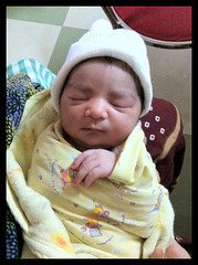 The Street Photographer One Day Old - Nerjis Asif Shakir by firoze shakir photographerno1