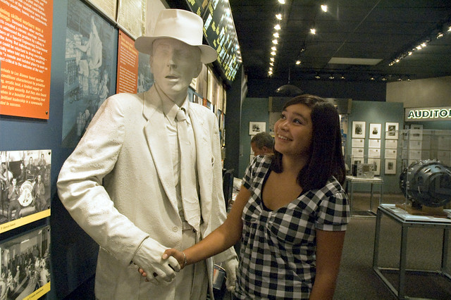 Young visitor shakes the hand of an Oppenheimer statue
