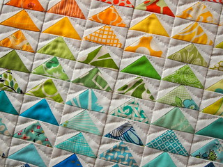 """99 bright flying geese"" doll quilt- detail"