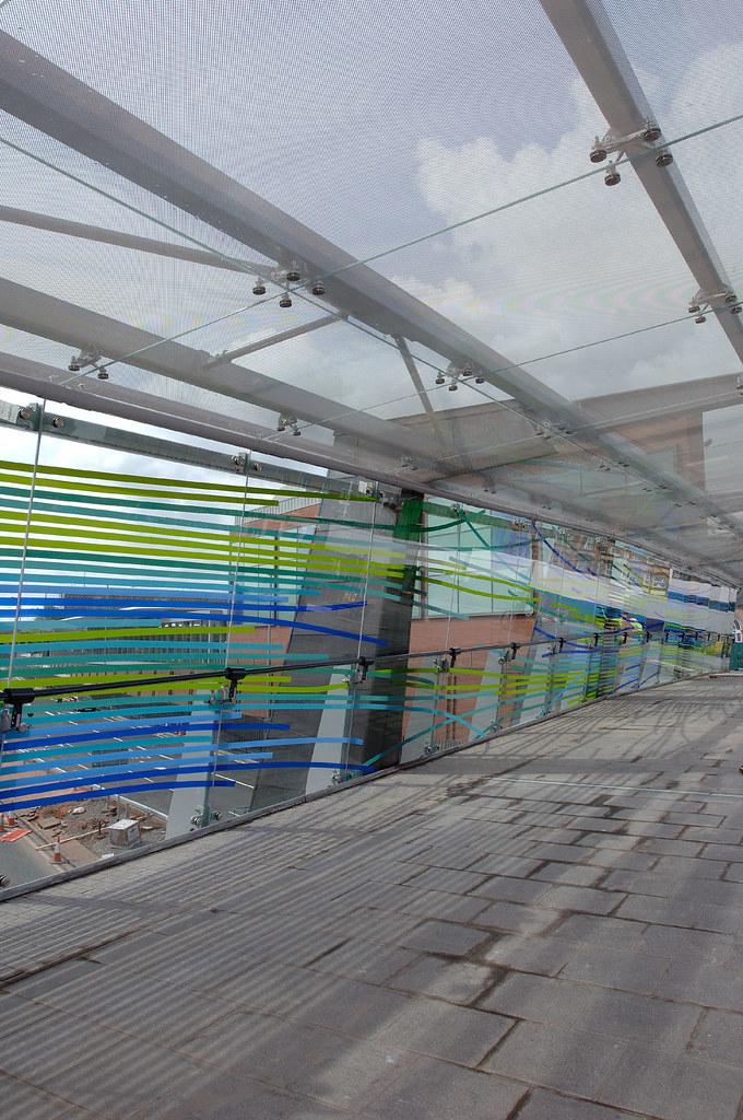 Curtain walling, planar glazing, bolted glass assemblies, artglass. link bridge DSC 0068