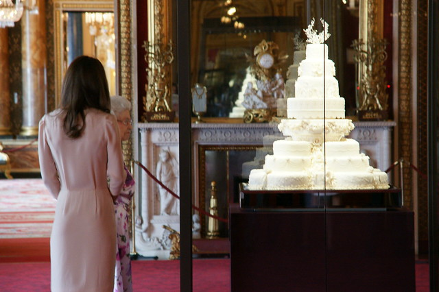 The Queen and The Duchess of Cambridge look at the wedding cake