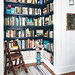Real Simple / Nikolas Koenig {closet - turned - library with black shelves}