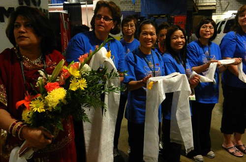 Volunteers in blue shirts with khatas, flower offerings, preparing for mandala offering to His Holiness 14th Dalai Lama of Tibet, Kalachakra for World Peace, Verizon Center, Washington D.C., USA by Wonderlane