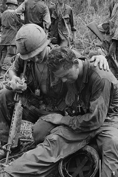 An unidentified American soldier is comforted by a comrade after breaking down under the strain of combat following a battle about 55 miles west of Pleiku, 1967, unattributed